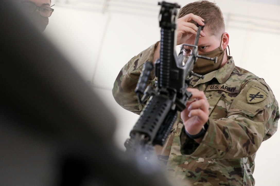 "U.S. Army Reserve Spc. Timothy Lowitzer, a Philadelphia, Pennsylvania native, and civil affairs specialist with the 1001st Civil Affairs and Psychological Operations Company, assembles an M249 squad automatic weapon during the first day of the 2021 U.S. Army Civil Affairs and Psychological Operations Command (Airborne) Best Warrior Competition at Fort Jackson, S.C., April 7, 2021. The USACAPOC(A) BWC is an annual competition that brings in the best Soldiers across USACAPOC(A) to earn the title of ""Best Warrior."" BWC tests the Soldiers' individual ability to adapt and overcome challenging scenarios and battle-focused events, testing their technical and tactical skills under stress and extreme fatigue."