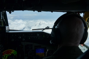 U.S. Air Force Capt. Trevor Gardner, 909th Air Refueling Squadron KC-135 Stratotanker pilot, looks at Mt. Fuji, Japan, April 1, 2021. The 909th ARS's mission is to refuel aircraft in the air, enabling Pacific Air Forces to maintain a free and open Indo-Pacific. (U.S. Air Force photo by Senior Airman Rebeckah Medeiros)