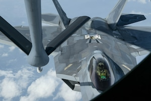 A U.S. Air Force F-22 Raptor, from the 199th Fighter Squadron, is being refueled by a KC-135 Stratotanker, from the 909th Air Refueling Squadron, during a 5th generation fighter operation near Japan, April 1, 2021. The F-22 Raptors are currently operating out of Marine Corps Air Station Iwakuni, Japan, to support U.S. Indo-Pacific Command's dynamic force employment concept. (U.S. Air Force photo by Senior Airman Rebeckah Medeiros)