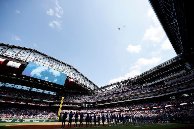 F-16C Fighting Falcon pilots assigned to the 457th Fighter Squadron, 301st Fighter Wing, U.S. Naval Air Station Joint Reserve Base Fort Worth, Texas performed a flyover during the opening ceremony for Major League Baseball's Texas Rangers team on Opening Day at Globe Life Field, April 5, 2021. The stadium opened for the first time to the public for a Texas Rangers game since its construction in 2020.