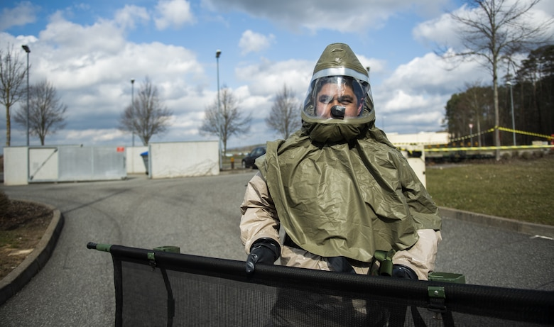 A U.S. Air Force Airman from the 52nd Medical Group carries a gurney to a pop-up decontamination site behind the 52nd MDG at Spangdahlem Air Base, Germany, March 26, 2021. During this portion of the exercise, Airmen subdued and comforted patients in a state of panic from the simulated disaster at the base theater. (U.S. Air Force photo by Senior Airman Ali Stewart)