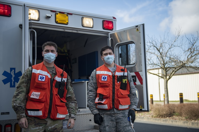 Two U.S. Air Force 52nd Medical Group ambulatory services Airmen pose for a photo near an ambulance at Spangdahlem Air Base, Germany, March 26, 2021. During exercise Ready EAGLE, ambulatory services dispatched to the scene of a simulated disaster at the base theater. (U.S. Air Force photo by Senior Airman Ali Stewart)