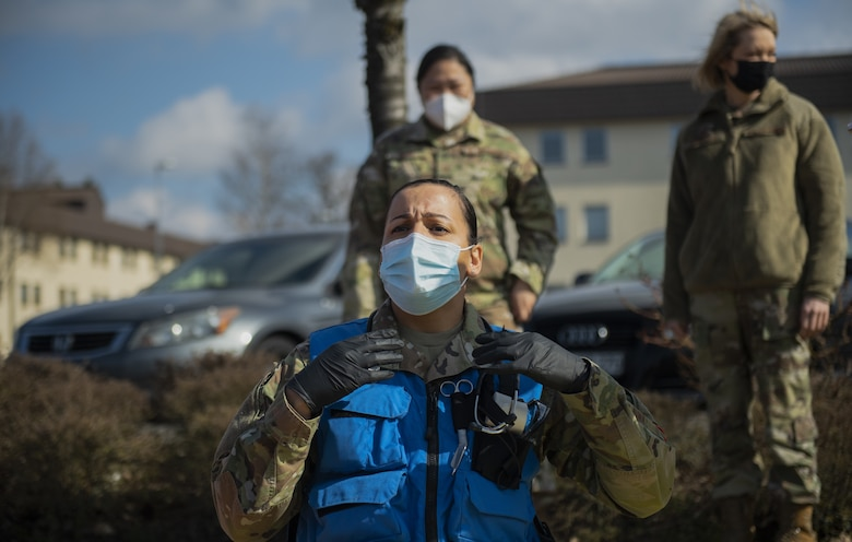 U.S. Air Force Tech. Sgt. Adrianne Littles, 52nd Medical Group independent duty medical technician, calls out for supplies during a simulated disaster exercise at the theater on Spangdahlem Air Base, Germany, March 26, 2021. Exercise Ready EAGLE tested the disaster response capabilities of Airmen within the 52nd MDG. (U.S. Air Force photo by Senior Airman Ali Stewart)
