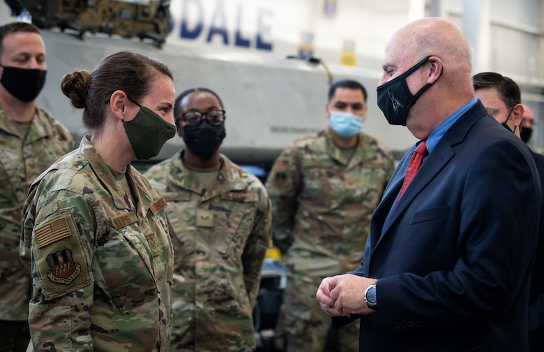Tech. Sgt. Marcella Phillips, 2nd Maintenance Group load standardization crew member, is presented a coin from Honorable John P. Roth, acting Secretary of the Air Force, during a tour at Barksdale Air Force Base, Louisiana, April 6, 2021.