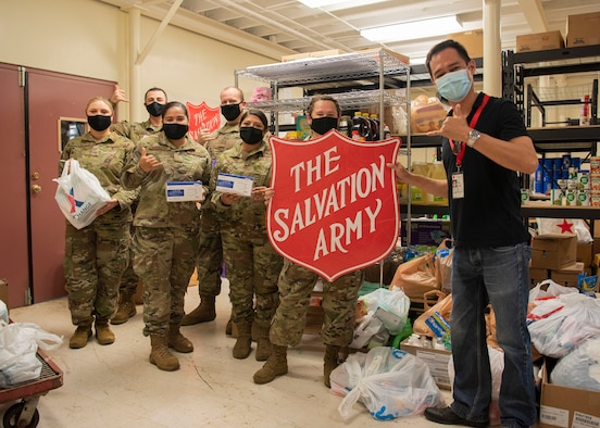 U.S. Air Force Airmen from Andersen Air Force Base's Air Force Sergeants Association Chapter 1560 donate essential items at The Salvation Army Guam Corps headquarters in Barrigada, Guam, April 8, 2021. The AFSA members garnered more than 1,800 items through donation drives during the month of March, which totaled to $10,000 in assistance for The Salvation Army. (U.S. Air Force photo by Senior Airman Aubree Owens)