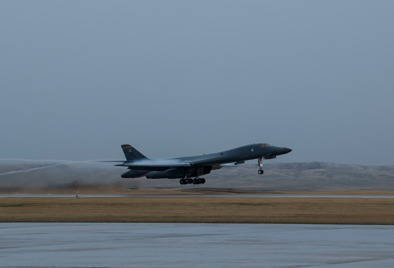 A B-1B Lancer takes off in support of a Bomber Task Force mission at Ellsworth Air Force Base, S.D., April 6, 2021. Bomber Task Force missions allow the U.S., to routinely and visibly demonstrate commitment to our Allies and partners through the global employment of our military. (U.S. Air Force photo by Senior Airman Christina Bennett)
