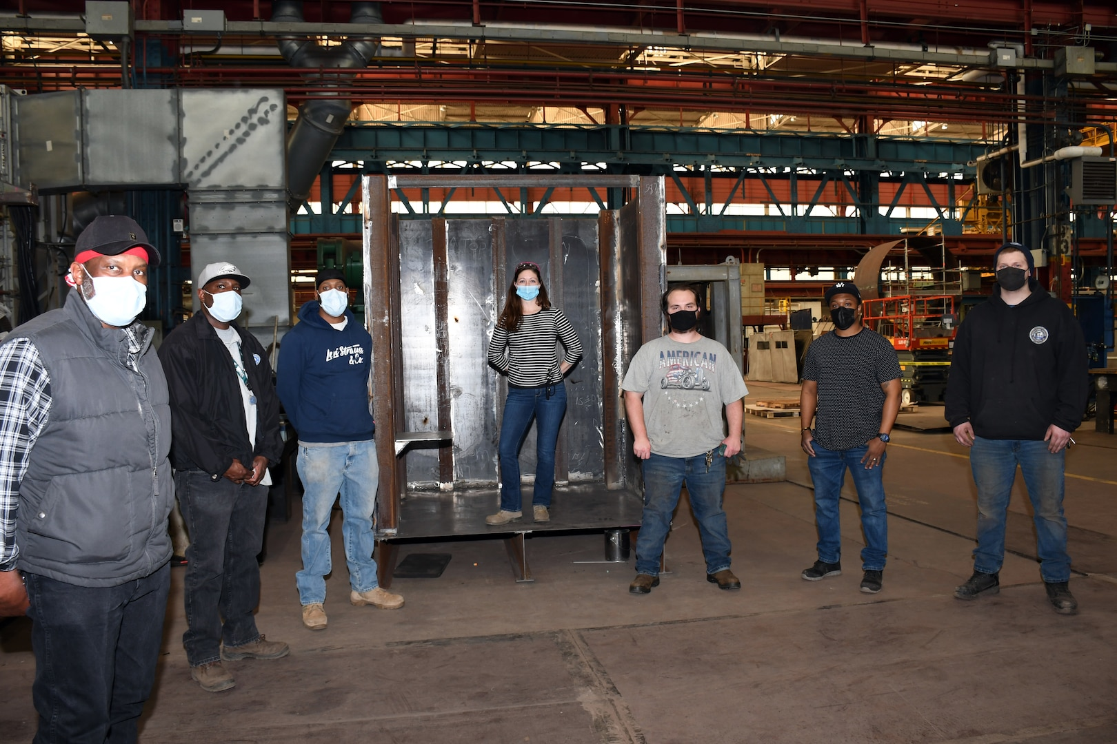 Employees of Norfolk Naval Shipyard's Metal Inspectors Division (Code 135), shipfitting shop (Shop 11) and welding shop (Shop 26) stand by one of their newest welding mock up pieces. These pieces are used to help train, develop and simulate real life welding and inspection scenarios.