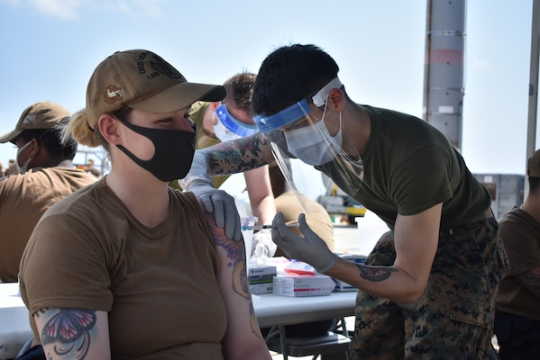 OKINAWA, Japan (Mar. 16, 2021) Boatswain's Mate 2nd Class Anjellica Beyner, from Kissimmee, Fla., assigned to the amphibious dock landing ship USS Germantown (LSD 42), receives the second dose of the Moderna COVID-19 vaccine. Germantown, part of Amphibious Squadron 11, along with the 31st Marine Expeditionary Unit, is operating in the U.S. 7th Fleet area of responsibility to enhance interoperability with allies and partners and serve as a ready response force to defend peace and stability in the Indo-Pacific region. (U.S. Navy photo by Lt. j.g. Yeltsin E. Rodriguez)