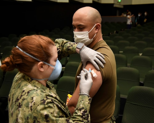 SASEBO, Japan (Feb. 3, 2021) – Lt. j.g. Jake Boldes, from Seattle, assigned to the USS Green Bay (LPD 20), receives a Moderna COVID-19 vaccine from Hospital Corpsman 3rd Class Keating Beach, from Frederick, Md.,  assigned to U.S. Naval Hospital Yokosuka Branch Health Clinic Sasebo onboard Commander, Fleet Activities Sasebo Feb. 3, 2021. Green Bay, part of Amphibious Squadron 11, is forward deployed to the U.S. 7th Fleet area of operations to enhance interoperability with allies and partners and serve as a ready response force to defend peace and stability in the Indo-Pacific region. (U.S. Navy photo by Mass Communication Specialist 2nd Class Gregory A. Pickett II)