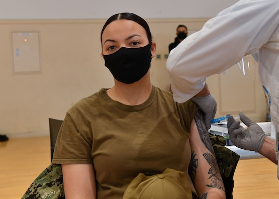 YOKOSUKA, Japan (Jan. 30, 2021) – Hospital Corpsman 3rd Class Jasmine Michales, from Jackson, Mississippi, receives her first dose of the COVID-19 Vaccine, as part of the DoD's phased vaccine rollout for voluntary inoculations across the fleet, including 7th Fleet's Forward Deployed Naval Forces (FDNF). Blue Ridge is the oldest operational ship in the Navy and, as 7th Fleet command ship, actively works to foster relationships with allies and partners in the Indo-Pacific region. (U.S. Navy photo by Mass Communication Specialist Seaman Erik M. Rivera Jr.)
