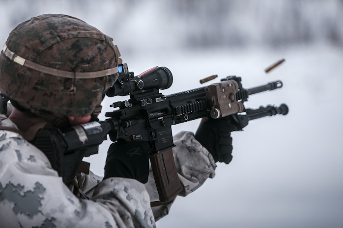 U.S. Marines with Marine Rotational Force Europe 21.1 (MRF-E), Marine Forces Europe and Africa, fire down range during a company live-fire attack as part of Exercise Arctic Littoral Strike in Blåtind, Norway, March 30, 2021.