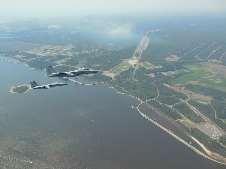 NORAD F-15 jet fighters flew simultaneously off both U.S coasts for Exercise Noble Defender April 6. Noble Defender simulated air defense of ports in the southeast and southwest.
