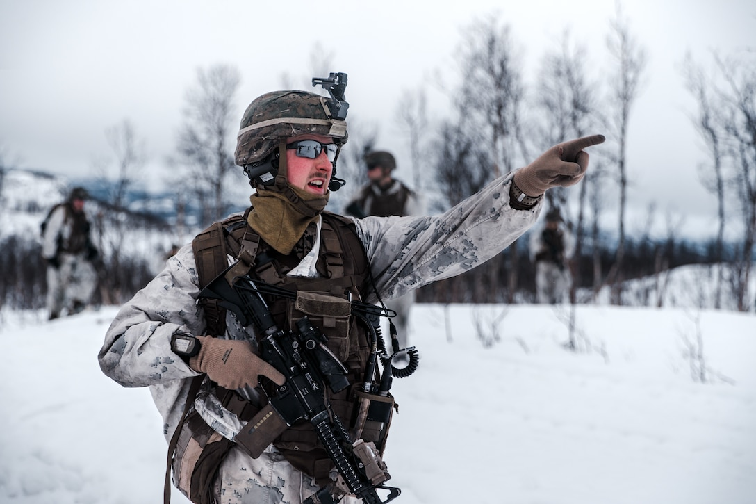 A U.S. Marine communicates with Marines down range as part of Exercise Arctic Littoral Strike in Blåtind, Norway, March 30.
