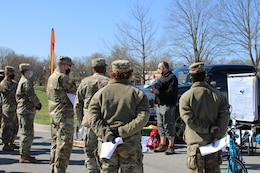 civilian man trains soldiers about bike safety
