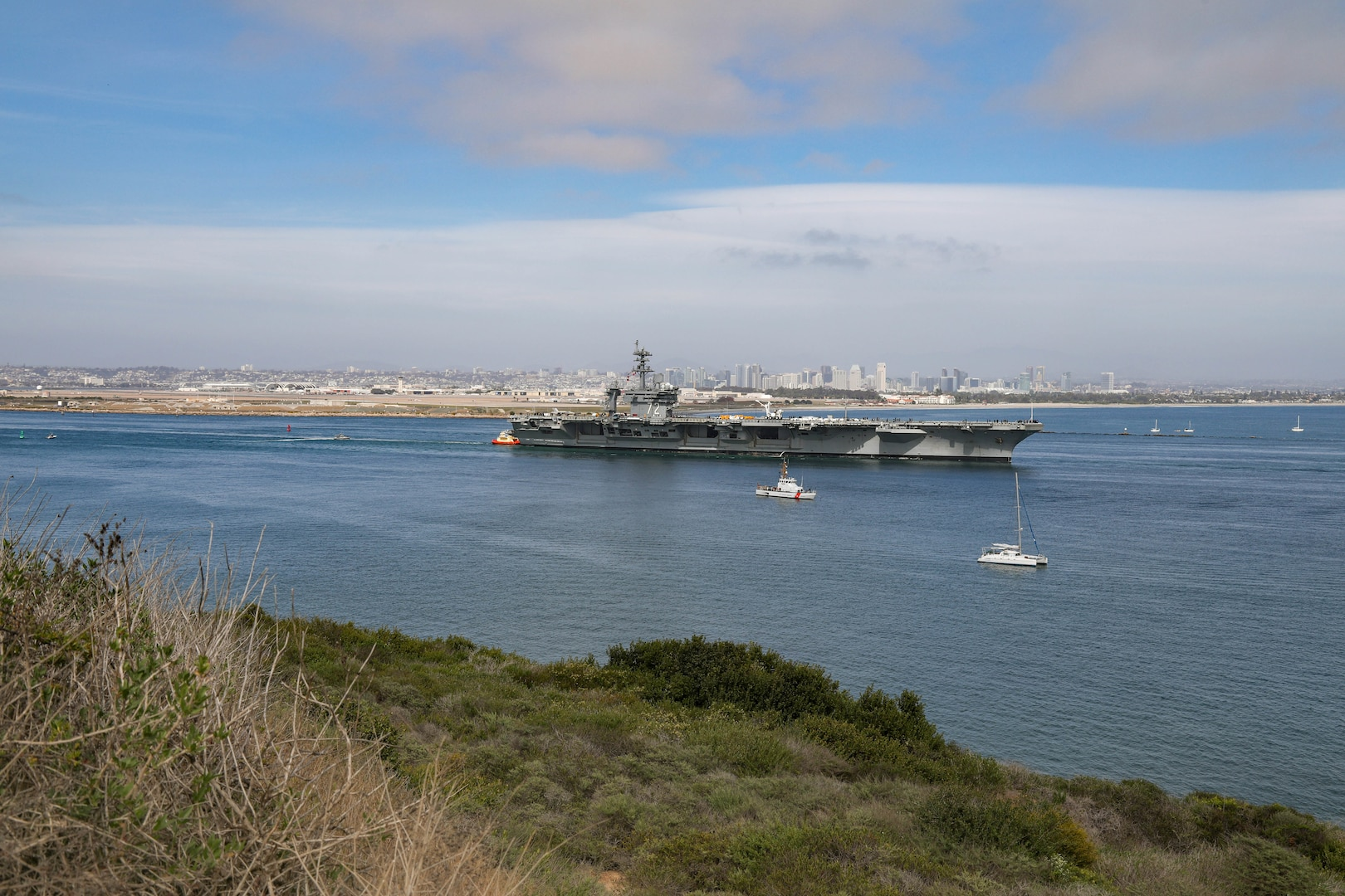 USS Abraham Lincoln (CVN 72) departs San Diego April 5, 2021, headed out to sea trials after undergoing a seven-month Planned Incremental Availability at Puget Sound Naval Shipyard & Intermediate Maintenance Facility's San Diego Detachment. Lincoln successfully completed sea trials April 7, 2021. (PSNS & IMF photo by Robin Lee)