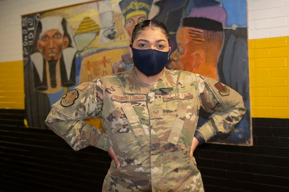 Staff Sgt. Madeline Negron-Lisboa, from Norwich, Conn., and 335th Expeditionary Medical Operations Squadron general purpose Airman, takes a short break at the state-led, federally-supported Medgar Evers College Community Vaccination Center in Brooklyn, N.Y., March 22, 2021. Negron-Lisboa, who is deployed from the 325th Logistics Readiness Squadron out of Tyndall Air Force Base, Fla., was born in Puerto Rico and translates for Spanish-speaking community members who have questions while receiving their COVID-19 vaccination. (U.S. Air Force photo by Tech. Sgt. Ashley Nicole Taylor)