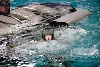 A Kentucky Army National Guard cadet with the University of Kentucky's ROTC program gasps for air after being under water during advanced underwater egress training March 12, 2021, under the direction of the 160th Special Operations Aviation Regiment's Dunker Training instructors at Fort Campbell, Ky.