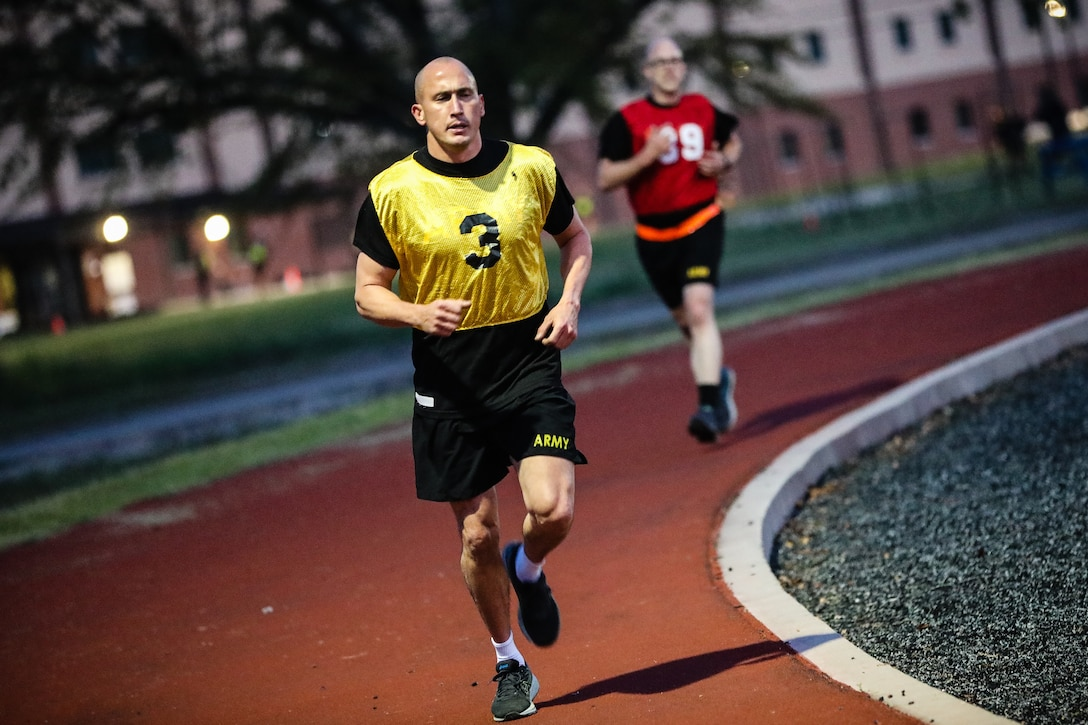 """U.S. Army Reserve Staff Sgt. Jonathan P. Chacon, left, a civil affairs specialist with the 426th Civil Affairs Battalion (Airborne), and Spc. Daniel P. Bush, a civil affairs specialist with the 352nd Civil Affairs Command, participate in the Army Combat Fitness Test during the second day of the 2021 U.S. Army Civil Affairs and Psychological Operations Command (Airborne) Best Warrior Competition at Fort Jackson, S.C., April 8, 2021. The USACAPOC(A) BWC is an annual competition that brings in competitors from across USACAPOC(A) to earn the title of """"Best Warrior."""" BWC tests the Soldiers' individual ability to adapt and overcome challenging scenarios and battle-focused events, testing their technical and tactical skills under stress and extreme fatigue"""