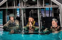 A Kentucky Army National Guard cadet with the University of Kentucky's ROTC program in the 'Dunker' during advanced underwater egress training March 12, 2021, under the direction of the instructors with the 160th Special Operations Aviation Regiment at Fort Campbell, Ky.