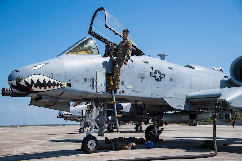 Aircraft maintainers from the 23rd Maintenance Squadron inspect an A-10C Thunderbolt II aircraft assigned to the 74th Fighter Squadron, March 18, 2021, at MacDill Air Force Base, Fla