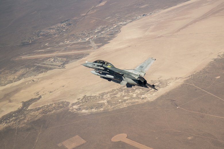 An F-16 assigned to the 416th Flight Test Squadron flies into position over the Precision Impact Range Area on Edwards Air Force Base, California, Feb. 26. The successful drop test was in support of the Korea F-16 Update Program. The ROKAF currently operates 133 KF-16C/D Block 50/52 fighter aircraft, all of which will undergo extensive modernization and upgrades as part of the comprehensive improvement program. Lockheed Martin was awarded a $1.2 billion contract to retrofit the 133 KF-16s and upgrade them to the advanced F-16V configuration, which is the latest technologically and most advanced version of the fourth generation fighter jet. (Air Force photo by Ethan Wagner)