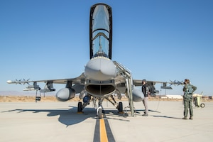 Crews prepare an F-16 assigned to the 416th Flight Test Squadron for a bomb drop test sortie at Edwards Air Force Base, California, Feb. 26. The successful drop test was in support of the Korea F-16 Update Program. The ROKAF currently operates 133 KF-16C/D Block 50/52 fighter aircraft, all of which will undergo extensive modernization and upgrades as part of the comprehensive improvement program. Lockheed Martin was awarded a $1.2 billion contract to retrofit the 133 KF-16s and upgrade them to the advanced F-16V configuration, which is the latest technologically and most advanced version of the fourth generation fighter jet. (Air Force photo by Ethan Wagner)
