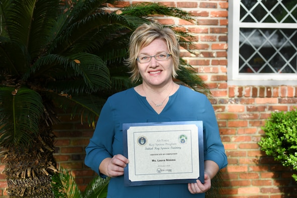 Photo of person holding a certificate