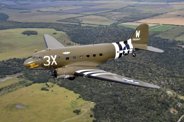 """Aerial picture of the C-47 """"That's All, Brother"""" flying."""