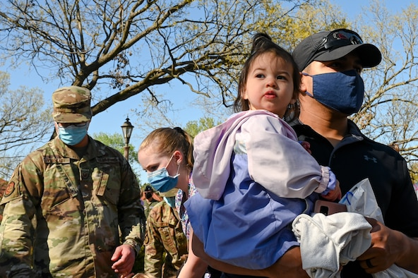 Military children pose for a photo during the Military Child Parade at Barksdale Air Force Base, Louisiana, April 1, 2021.
