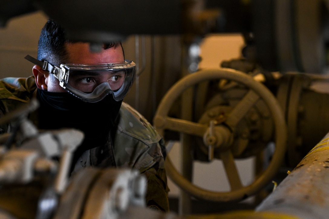 Airman 1st Class Carlos Cruz-Vasquez, 436th Logistics Readiness Squadron fuels laboratory technician, collects a fuel sample for testing at Dover Air Force Base, Delaware, Jan. 12, 2021. Fuel is inspected daily to ensure all aircraft receive the cleanest fuel possible, enabling them to effectively execute Team Dover's global airlift mission. (U.S. Air Force photo by Airman 1st Class Stephani Barge)