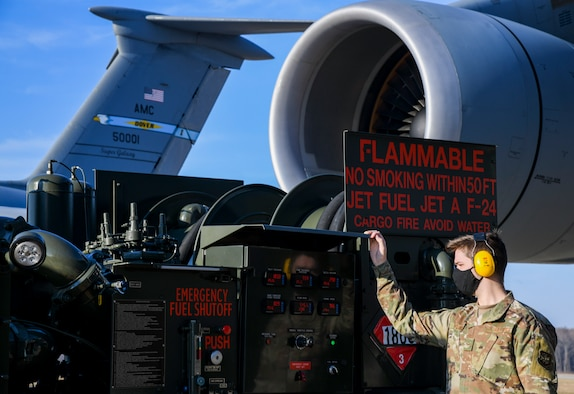 Airman 1st Class Cameron Hurst, 436th Logistics Readiness Squadron mobile distribution operator, reads a control panel on a fuel truck at Dover Air Force Base, Delaware, Jan. 13, 2021. Operators use the panel for important details about the fueling process, including the amount of fuel to be dispensed. (U.S. Air Force photo by Airman 1st Class Stephani Barge)