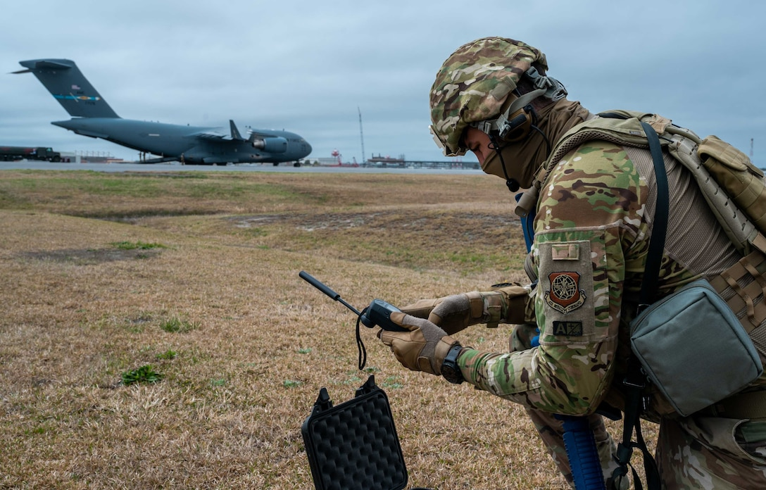 Senior Master Sgt. Daniel Graham, 436th Operational Support Squadron superintendent, adjusts radio frequencies during exercise Razor Talon at Marine Corps Air Station Cherry Point, North Carolina, March 23, 2021. Mobility Airmen participated in RT to enhance readiness and assist in implementation of the Agile Combat Employment concept across the Air Force. (U.S. Air Force photo by Airman 1st Class Faith Schaefer)
