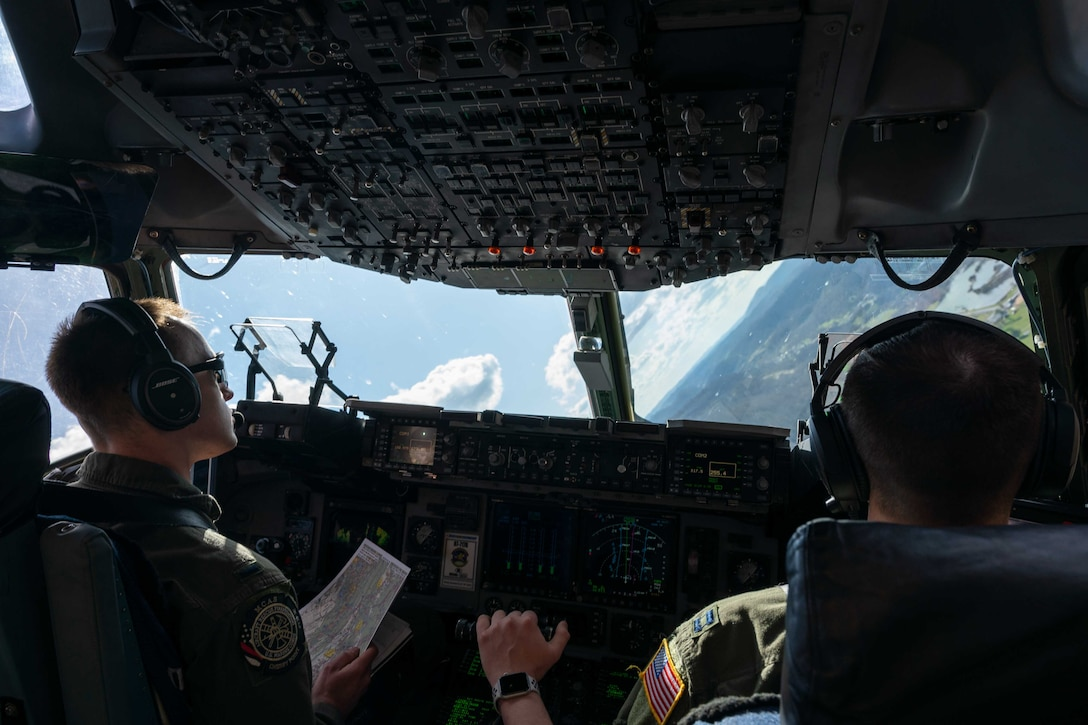 First Lt. Zachary Pruitt, left, and Capt. James Dimmick, both 3rd Airlift Squadron pilots, fly a Dover Air Force Base C-17 Globemaster III during exercise Razor Talon over North Carolina, March 24, 2021. Mobility Airmen participated in RT to enhance readiness and assist in implementation of the Agile Combat Employment concept across the Air Force. (U.S. Air Force photo by Airman 1st Class Faith Schaefer)