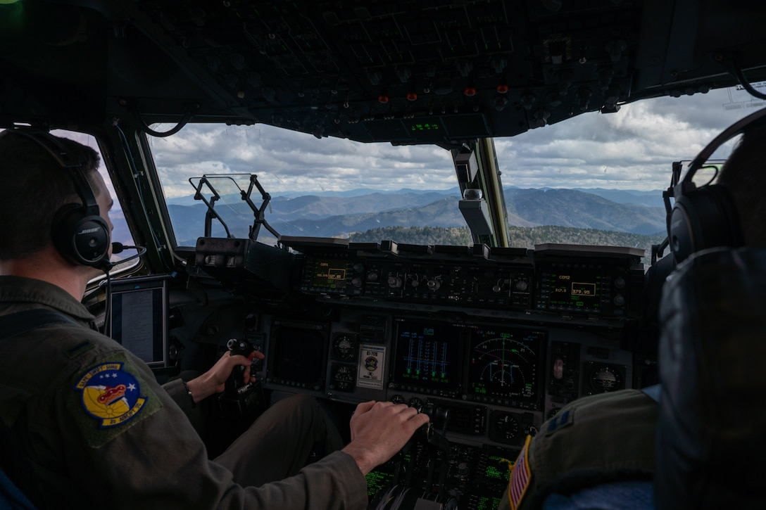 First Lt. Brent Johnson, left, and Capt. James Dimmick, both 3rd Airlift Squadron pilots, fly a Dover Air Force Base C-17 Globemaster III during exercise Razor Talon over North Carolina, March 24, 2021. Mobility Airmen participated in RT to enhance readiness and assist in implementation of the Agile Combat Employment concept across the Air Force. (U.S. Air Force photo by Airman 1st Class Faith Schaefer)