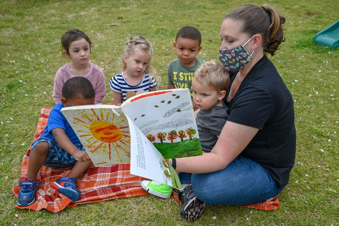 a woman reads to children