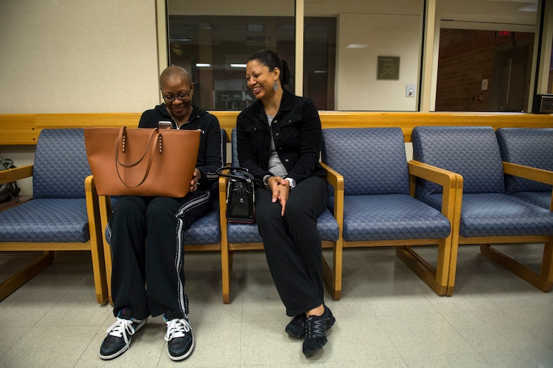 Staff Sgt. Chantel Thibeaux, Joint Base-Fort Sam Houston, Texas, dental assistant instructor, shares a laugh with her mother Carla while watching a video on her phone. As Thibeaux and her mother waited for doctors to perform checks prior to double mastectomy surgery, Carla kept her daughter in good spirits with laughs and loving reminders. (U.S. Air Force photo/Staff Sgt. Vernon Young Jr.)