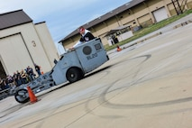 Airman driving a bomb lift vehicle