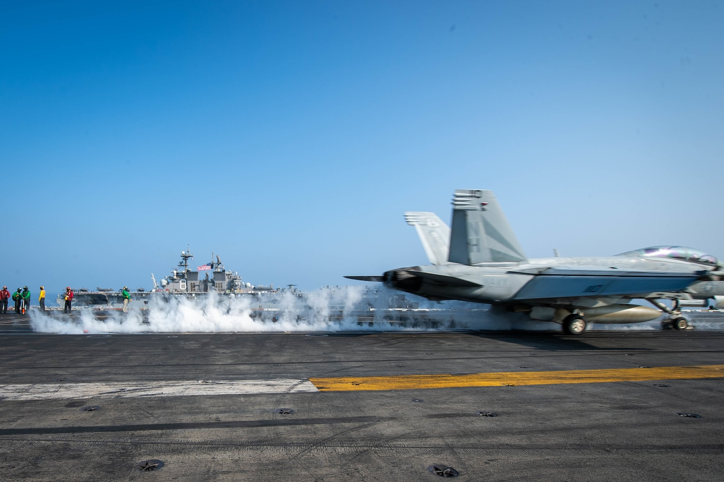 """SOUTH CHINA SEA (April 9, 2021) – An F/A-18F Super Hornet, assigned to the """"Black Knights"""" of Strike Fighter Squadron (VFA) 154, launches from the flight deck of the aircraft carrier USS Theodore Roosevelt (CVN 71) in the South China Sea April 9, 2021. The Theodore Roosevelt Carrier Strike Group, Makin Island Amphibious Ready Group and the Ticonderoga-class guided-missile cruiser USS Port Royal (CG 73) are conducting expeditionary strike force operations during their deployments to the 7th Fleet area of operations. As the U.S. Navy's largest forward-deployed fleet, 7th Fleet routinely operates and interacts with 35 maritime nations while conducting missions to preserve and protect a free and open Indo-Pacific region. (U.S. Navy photo by Mass Communication Specialist 3rd Class Dartañon D. De La Garza)"""