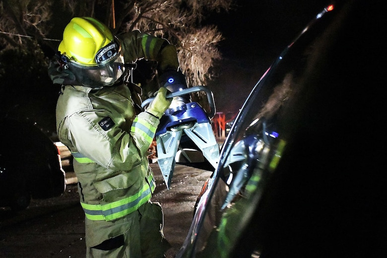 Firefighters from the 152nd Civil Engineer Squadron use the jaws of life to open a car door during Operation Chemical Blackjack Mar. 7, 2021, at the Nevada Air National Guard base in Reno. The three-day exercise was designed to ensure Airmen are ready for chemical, biological, radiological or nuclear (CBRN) threats is presented.