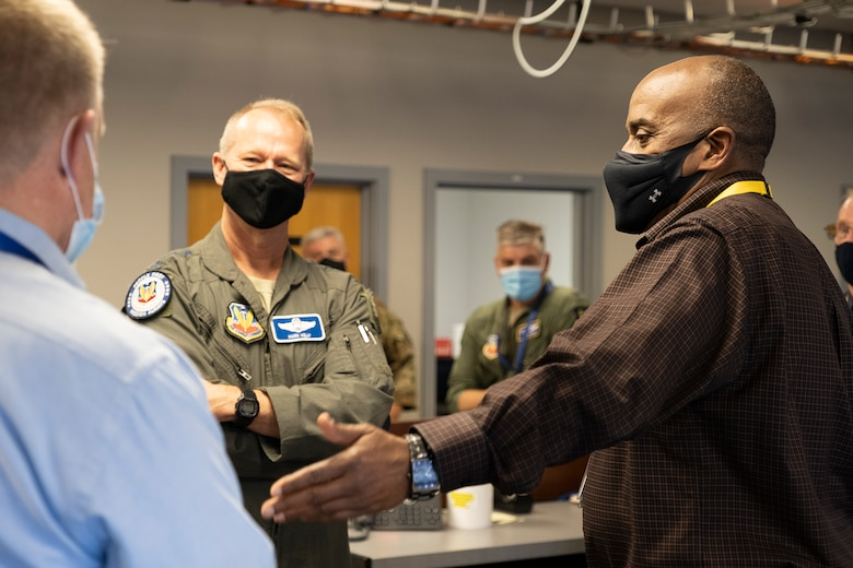 photo of Gen. Kelly talking to two civilians