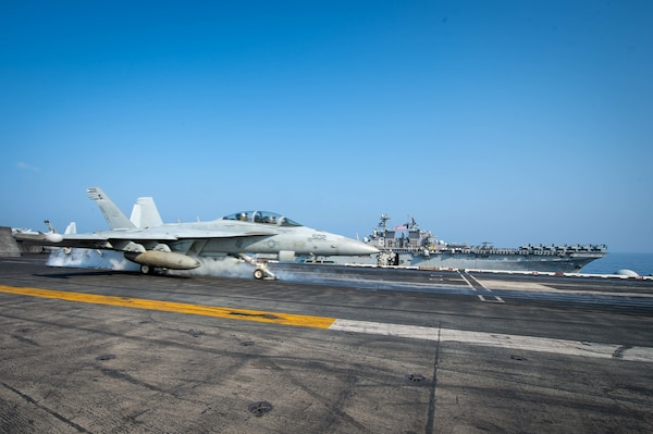 "SOUTH CHINA SEA (April 9, 2021) – An EA-18G Growler, assigned to the ""Gray Wolves"" of Electronic Attack Squadron (VAQ) 142, launches from the flight deck of the aircraft carrier USS Theodore Roosevelt (CVN 71) in the South China Sea April 9, 2021. The Theodore Roosevelt Carrier Strike Group, Makin Island Amphibious Ready Group and the Ticonderoga-class guided-missile cruiser USS Port Royal (CG 73) are conducting expeditionary strike force operations during their deployments to the 7th Fleet area of operations. As the U.S. Navy's largest forward-deployed fleet, 7th Fleet routinely operates and interacts with 35 maritime nations while conducting missions to preserve and protect a free and open Indo-Pacific region. (U.S. Navy photo by Mass Communication Specialist 3rd Class Dartañon D. De La Garza)"