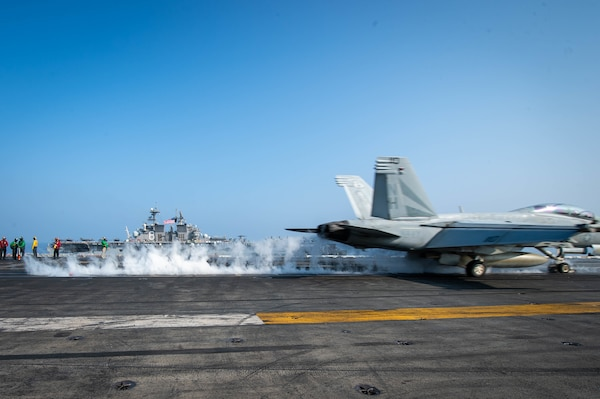 "SOUTH CHINA SEA (April 9, 2021) – An F/A-18F Super Hornet, assigned to the ""Black Knights"" of Strike Fighter Squadron (VFA) 154, launches from the flight deck of the aircraft carrier USS Theodore Roosevelt (CVN 71) in the South China Sea April 9, 2021. The Theodore Roosevelt Carrier Strike Group, Makin Island Amphibious Ready Group and the Ticonderoga-class guided-missile cruiser USS Port Royal (CG 73) are conducting expeditionary strike force operations during their deployments to the 7th Fleet area of operations. As the U.S. Navy's largest forward-deployed fleet, 7th Fleet routinely operates and interacts with 35 maritime nations while conducting missions to preserve and protect a free and open Indo-Pacific region. (U.S. Navy photo by Mass Communication Specialist 3rd Class Dartañon D. De La Garza)"