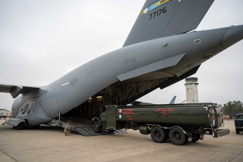 A fuel truck is loaded onto a Dover Air Force Base C-17 Globemaster III during exercise Razor Talon at Seymour Johnson AFB, North Carolina, March 23, 2021. Mobility Airmen participated in exercise Razor Talon to enhance readiness and assist in implementation of the Agile Combat Employment concept across the Air Force.