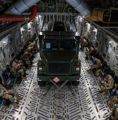 A fuel truck and passengers fly on a Dover Air Force Base C-17 Globemaster III during exercise Razor Talon at Seymour Johnson AFB, North Carolina, March 23, 2021. Mobility Airmen participated in Razor Talon to enhance readiness and assist in implementation of the Agile Combat Employment concept across the Air Force.