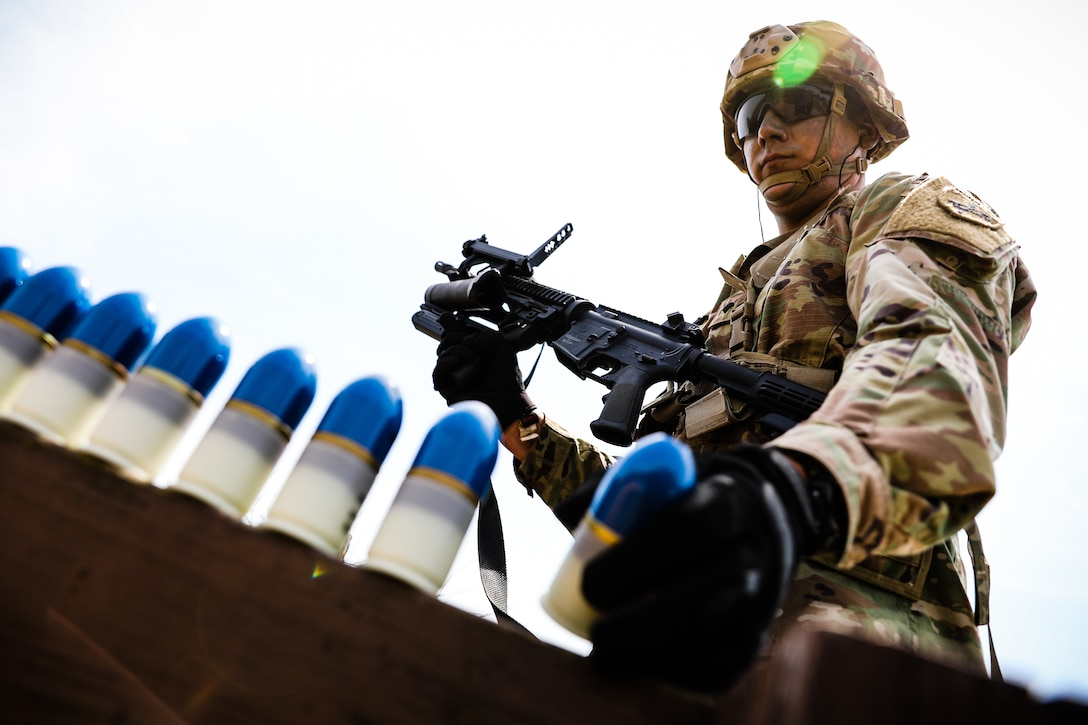 """U.S. Army Reserve Spc. Jaime Delgado, a civil affairs specialist with 412th Civil Affairs Battalion, prepares to load an M320 grenade launcher during day one of the 2021 U.S. Army Civil Affairs and Psychological Operations Command (Airborne) Best Warrior Competition at Fort Jackson, S.C., April 8, 2021. The USACAPOC(A) BWC is an annual event that brings in competitors from across USACAPOC(A) to earn the title of """"Best Warrior."""" BWC tests the Soldiers' individual ability to adapt and overcome challenging scenarios and battle-focused events, testing their technical and tactical skills under stress and extreme fatigue."""