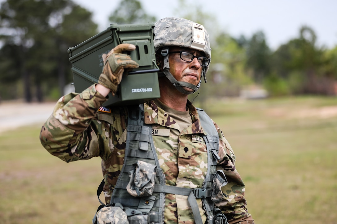 """U.S. Army Reserve Spc. Daniel P. Bush Jr., a civil affairs specialist with the 418th Civil Affairs Battalion, carries ammunition during day one of the 2021 U.S. Army Civil Affairs and Psychological Operations Command (Airborne) Best Warrior Competition at Fort Jackson, S.C., April 8, 2021. The USACAPOC(A) BWC is an annual event that brings in competitors from across USACAPOC(A) to earn the title of """"Best Warrior."""" BWC tests the Soldiers' individual ability to adapt and overcome challenging scenarios and battle-focused events, testing their technical and tactical skills under stress and extreme fatigue."""