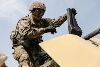 """U.S. Army Reserve Staff Sgt. Jonathan Chacon, right, a civil affairs specialist with the 426th Civil Affairs Battalion (Airborne), prepares to fire a Mk 19 automatic grenade launcher, during day one of the 2021 U.S. Army Civil Affairs and Psychological Operations Command (Airborne) Best Warrior Competition at Fort Jackson, S.C., April 8, 2021. The USACAPOC(A) BWC is an annual event that brings in competitors from across USACAPOC(A) to earn the title of """"Best Warrior."""" BWC tests the Soldiers' individual ability to adapt and overcome challenging scenarios and battle-focused events, testing their technical and tactical skills under stress and extreme fatigue."""