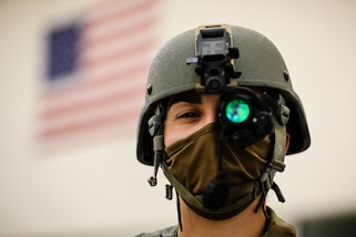 """U.S. Army Reserve Staff Sgt. Natalie Tedesco, a psychological operations specialist with the 303rd Tactical Psychological Operations Company, poses for a photo after preparing for a range qualification during the second day of the 2021 U.S. Army Civil Affairs and Psychological Operations Command (Airborne) Best Warrior Competition at Fort Jackson, S.C., April 8, 2021. The USACAPOC(A) BWC is an annual event that brings in competitors from across USACAPOC(A) to earn the title of """"Best Warrior."""" BWC tests the Soldiers' individual ability to adapt and overcome challenging scenarios and battle-focused events, testing their technical and tactical skills under stress and extreme fatigue."""