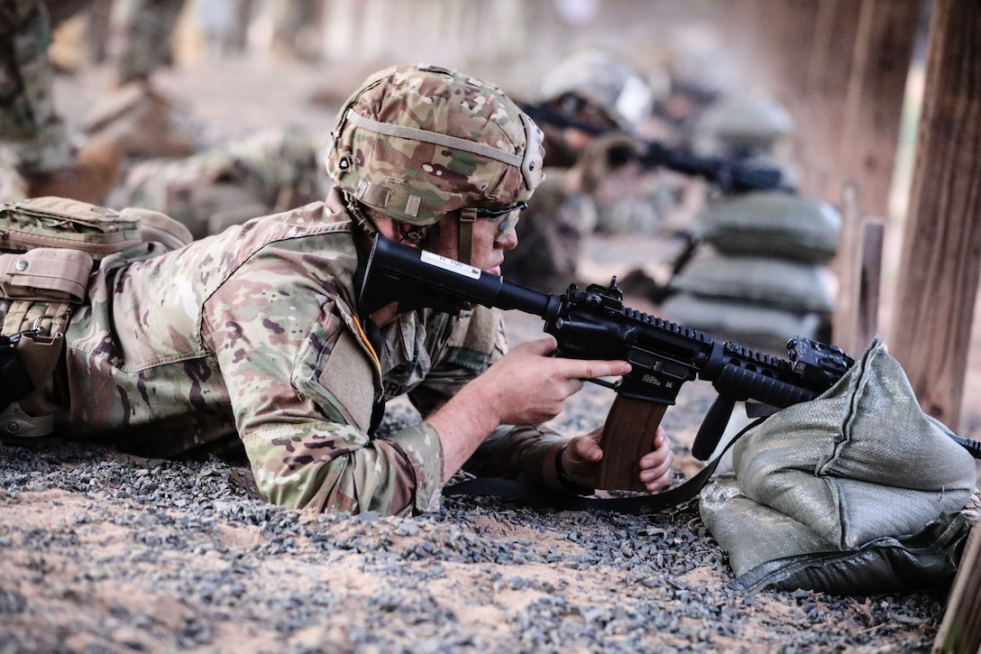 """U.S. Army Reserve Sgt. Shayn Lindquist, a civil affairs specialist with the 412th Civil Affairs Battalion, fires an M4 carbine during the second day of the 2021 U.S. Army Civil Affairs and Psychological Operations Command (Airborne) Best Warrior Competition at Fort Jackson, S.C., April 8, 2021. The USACAPOC(A) BWC is an annual event that brings in competitors from across USACAPOC(A) to earn the title of """"Best Warrior."""" BWC tests the Soldiers' individual ability to adapt and overcome challenging scenarios and battle-focused events, testing their technical and tactical skills under stress and extreme fatigue."""