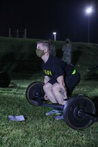 """U.S. Army Reserve Staff Sgt. Timothy J. Lowitzer, a Civil Affairs Specialist with the 1001st Civil Affairs & Psychological Operations Training Company, checks his deadlift weight prior to the Army Combat Fitness Test conducted at Ft. Jackson, S.C. Lowitzer is competing in the 2021 U.S. Army Civil Affairs and Psychological Operations Command (Airborne) Best Warrior Competition April 8 - 11, 2021. The USACAPOC(A) BWC is an annual competition that brings Soldiers from across the command to compete for the title of """"Best Warrior."""" BWC is designed to test each Soldiers' mental and physical resilience as they adapt and overcome each scenario or task placed before them."""